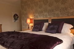 purple-bedroom-whitefalls-spa-lodges1